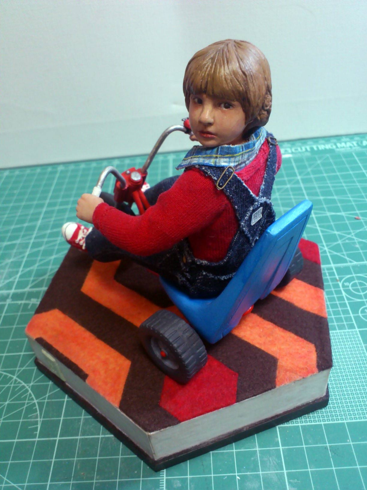 Close up shot in full body bird's view of miniature statue Danny Torrance