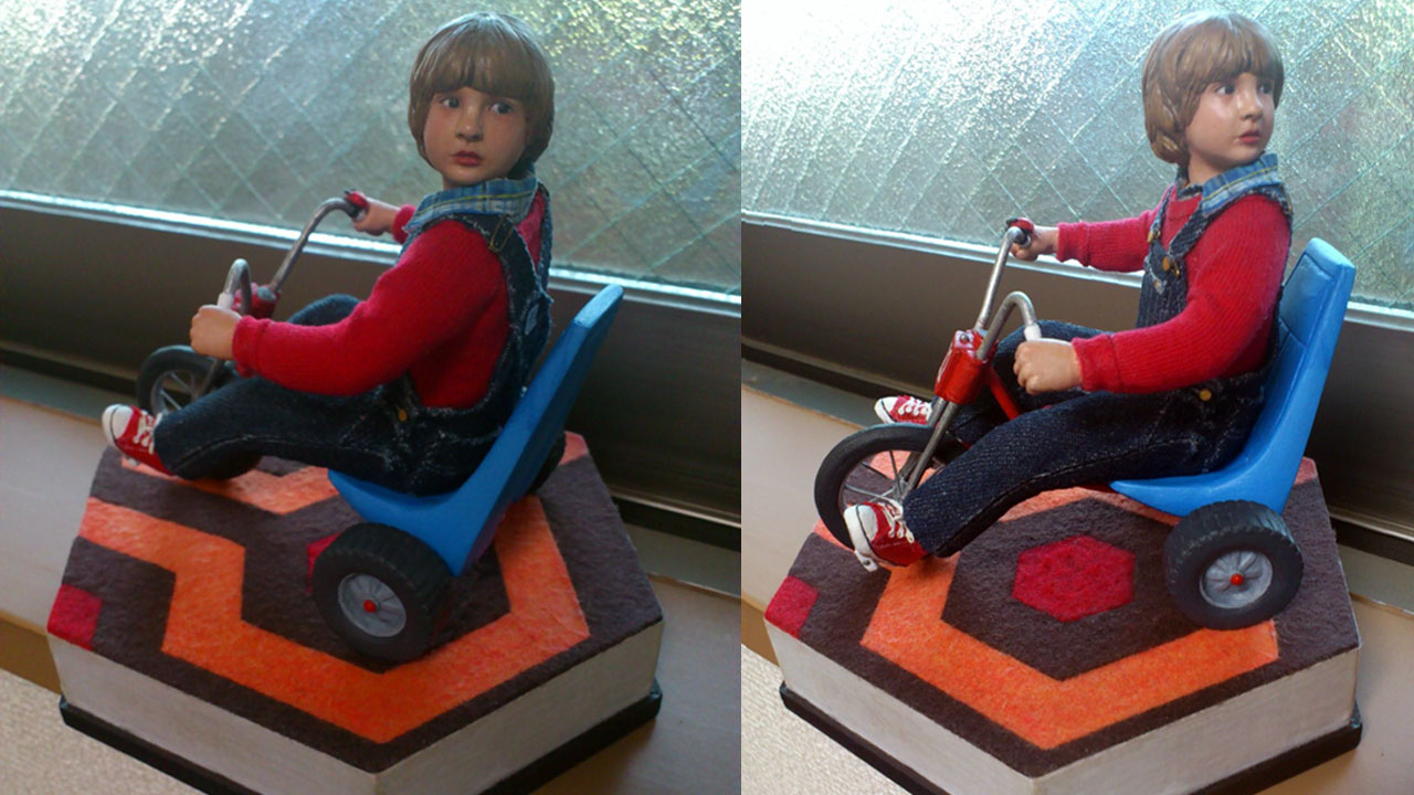 Two images side by side in full body shots of the completed miniature statue of Danny Torrance in various side views on base