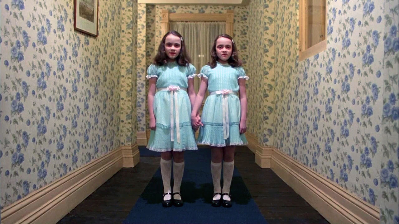 A screenshot of twin girls from the movie, The Shining.