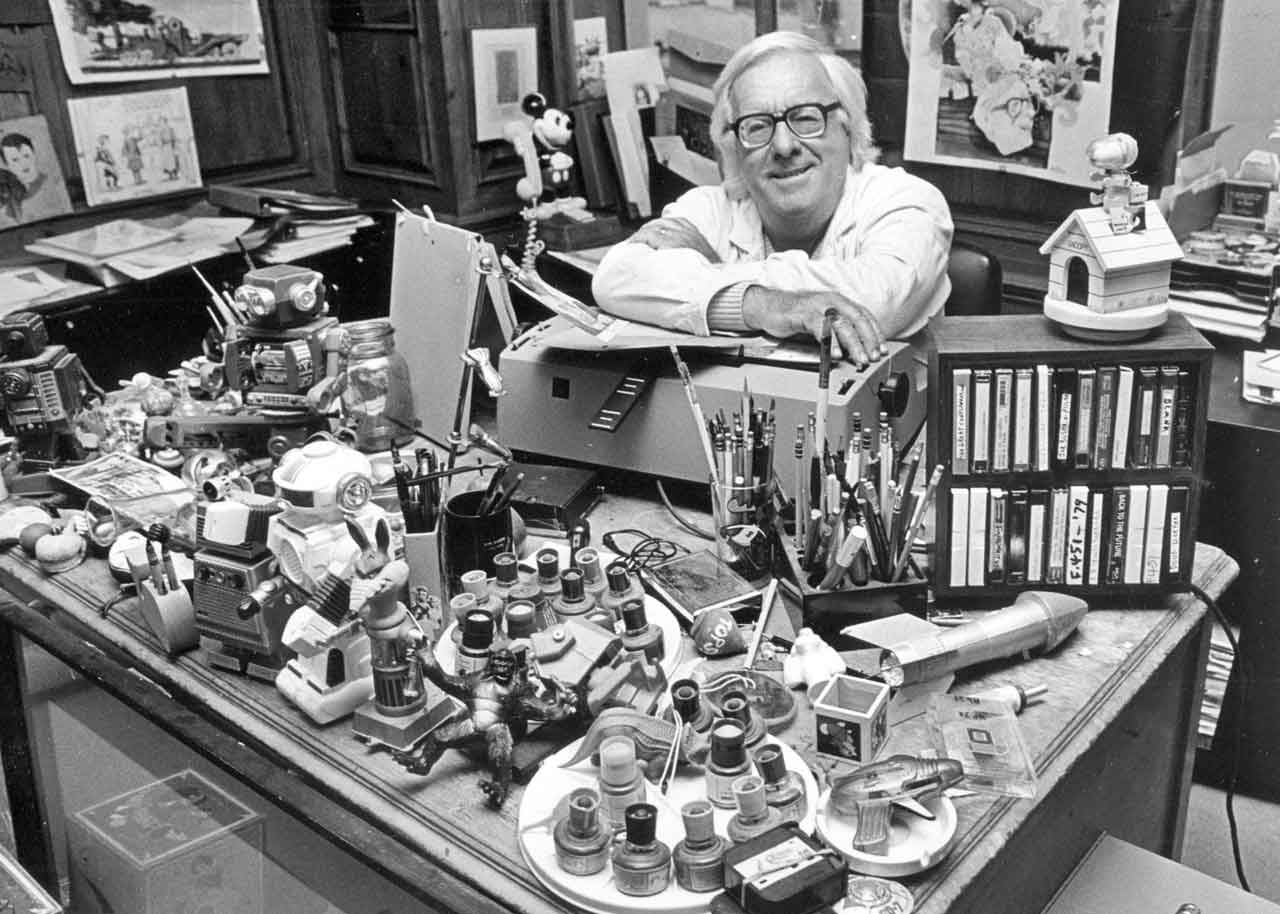 Black and white photo of author and renowned science fiction writer, Ray Bradbury at his desk