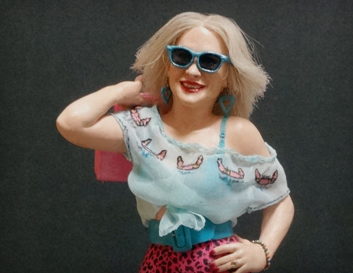Oscar Academy award winner Patricia Arquette as Alabama Worley in the Tony Scott classic, True Romance with blue sunglasses and carrying pink bag over shoulder statue by Marten Go aka MGO