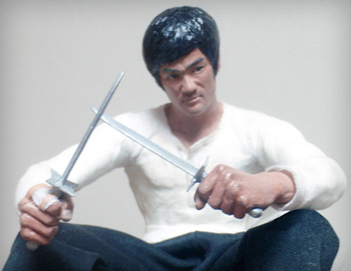 Bruce Lee as Cheng Chao-An in The Big Boss clutching two short knives statue by Marten Go aka MGO