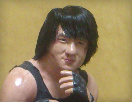 Jackie Chan as Thomas in Sammo Hung's Wheels on Meals with Yuen Biao wearing black tank top and black leather gloves statue by Marten Go aka MGO